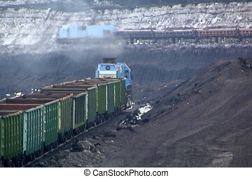 Coal mining - Coal wagons on railway tracks