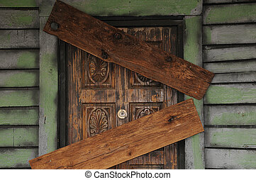 beware - old house boarded up