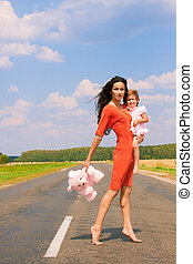 Beautiful woman holding her daughter