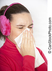 A sneezing cute young woman