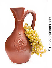 traditional clay jug for wine with bunch grapes -...
