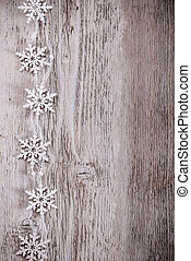 Artificial snowflakes on wooden background