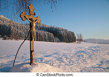 Cross in winterscene