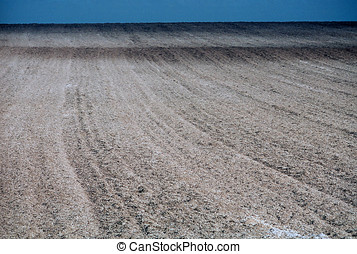 Furrowed chalky brown field - A furrowed chalky brown field...