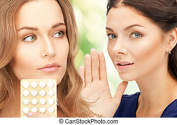 young beautiful women with pills - picture of young...