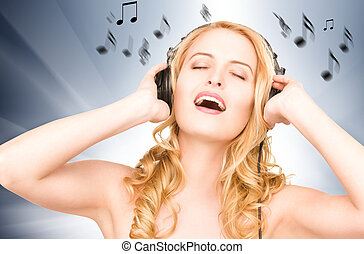 happy woman in headphones - picture of happy woman in...