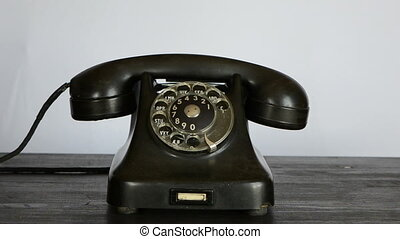 gangster hand calling phone - gangster hand with black glove...