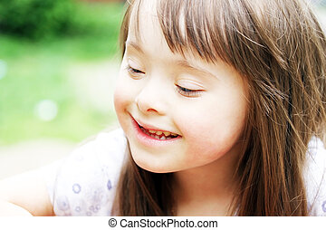 Portrait of beautiful young girl smiling in the park