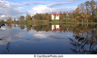 historical Birzai castle and Sirvena lake in autumn,...