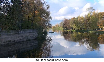 lonely fishermans boat on autumn river