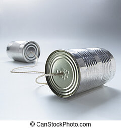 cans - two tin cans connected by a piece of string