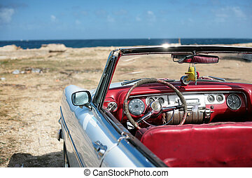 old auto - cuban vintage car parked on the seacost in havana