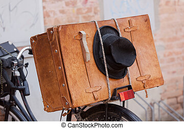Shabby Black Hat and Brown Suitcase. - Shabby black hat and...
