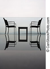 chairs - two chairs and table on landscape with hills and...
