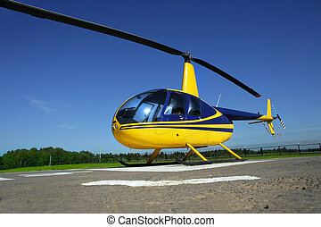 helicopter - Yellow - Blue helicopter standing in the...