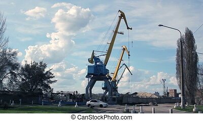 Port crane timelapse - Sand loading crane in a port....