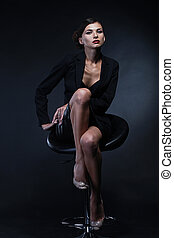 Portrait of sexy business woman in a suit Professional...