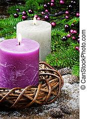 Burning candles on festive Christmas background