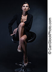 Portrait of sexy business woman in a suit. Professional...