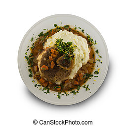Isolated osso buco meal on white background. - Osso buco...
