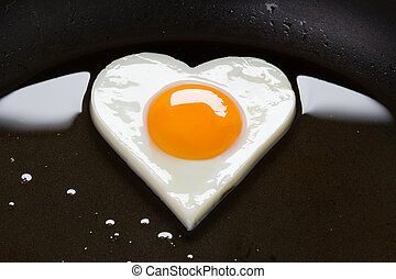heart shaped egg in a frying pan - heart shaped egg cooking...