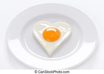 heart shaped egg on a plate - heart shaped cooked egg on a...