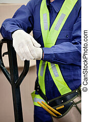 Midsection Of Young Foreman In Protective Clothing -...