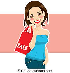Woman Shopping Sales - Attractive brunette woman carrying...