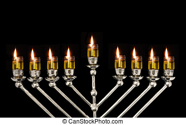 Chanukah oil menorah - Close up of a lighted oil menorah for...