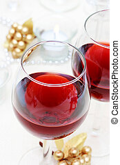 Holiday Red Wine - Two red wine glasses on the table with...