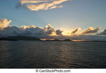 Cloudy skys at sunrise - The sun peaks through a cloudy sky...