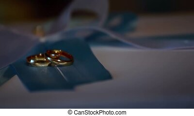 Wedding rings in a beam of light