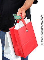 plastic shopper - man holding a plastic credit or debit card...
