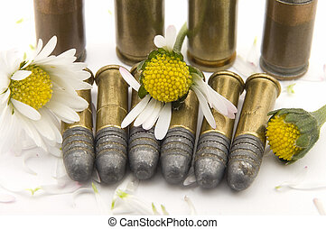 war and peace - several gun bullets on white background,...