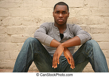 Serious Young African American Man Portrait Against Brick Wall