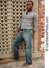 Sexy Young African American Man Leaning Against Grunge Backgroun