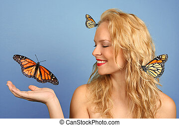 Woman With Many Butterflies in Hand and Her Hair