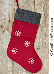 christmas sock hung on the wooden wall - Red christmas sock...