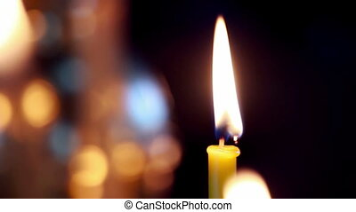 Wax candles in the orthodox church - Burning wax candles in...