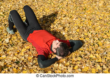 Athlete resting outdoors in autumn