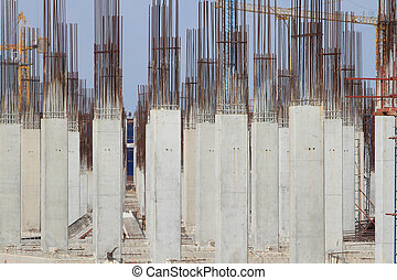 Construction site with enforced concrete steel frames rising up