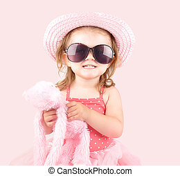 Young Pink Princess Child with Sunglasses - A young little...
