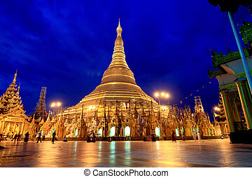 atmosphere of dusk at Shwedagon pagoda in Yagon, Myanmar -...