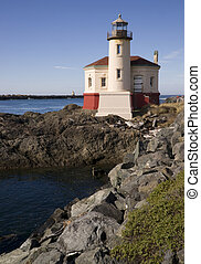 Coquille River Lighthouse - West Coast Lighthouse on a rocky...