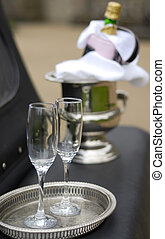 Two Champagne Glasses - Two Champagne glasses and bottle on...