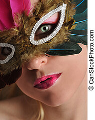 Beautiful Woman in Costume Mask - A woman has a feather mask...