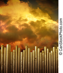 Wooden Fence Against Red Storm Clouds - A wooden fence is in...