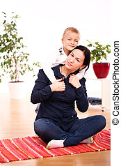 Mother with happy son at home