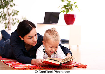 mother with son reading a book at home
