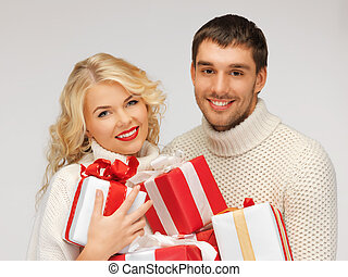 family couple in a sweaters with gift boxes - picture of...